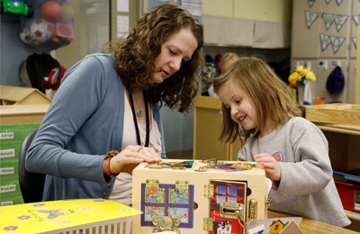 Meigen Fink, preschool teacher at Kirkwood Elementary School in Iowa City, guides a preschool student who through play, interactions with others, and program-wide PBIS, discovers how to unlock the potential of her own social-emotional competence.