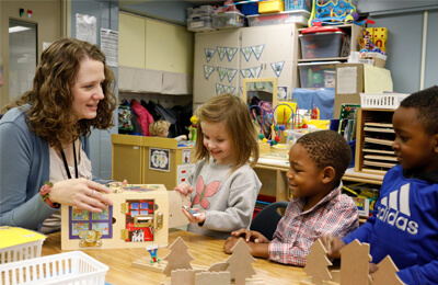 Meigen Fink, preschool teacher at Kirkwood Elementary School in the Iowa City, interacts with students in her classroom. The importance of play is embraced and emphasized in social-emotional learning for her preschoolers. Students work on basic interactions, and expressing feelings and emotions, and program-wide PBIS behavior concepts are woven into instruction throughout the day.
