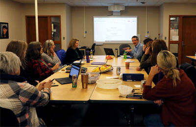 Jay Beaver, Preschool and Special Education Lead Support Teacher for the Iowa City Community School District, leads a discussion about data regarding the Family Early Childhood-PBIS Survey during a leadership team meeting pertaining to program-wide PBIS.