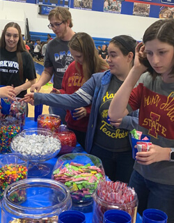 Students, sporting spirit wear from their prospective colleges, load up at the candy bar.