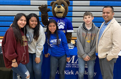 Eddie Diaz, executive director of DMACC's Perry Center, joined the DMACC bear to congratulate seniors and meet with underclassman.