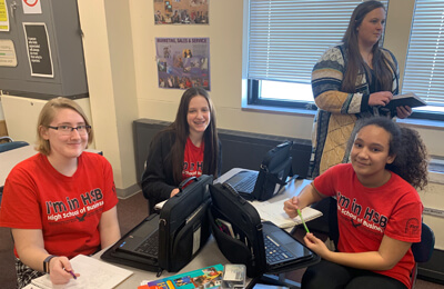Freshmen (L-R)Megan Anhalt, Kenadie Wichman and Emma Steemer work on a project in the principles of business class.