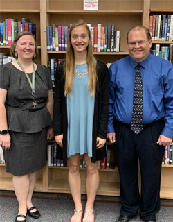 Megan Niewoehner is with Karen Van De Walle, agriculture instructor and Iowa Association for Career and Technical Education (IACTE) board member (L) and Steve Kalous, business instructor (R). Kalous nominated Megan for the U.S. Presidential Scholars in Career and Technical Education Program.