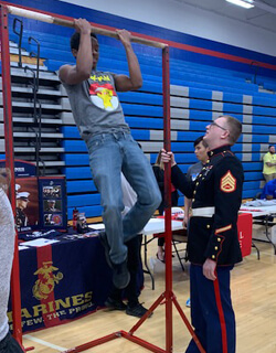 Students visiting the Marines booth had their stamina tested at the pull-up bar.