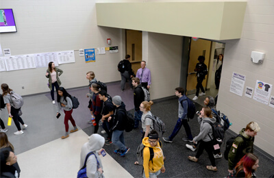 Students at Liberty High School are accustomed to interacting with staff, including administrative staff such as Principal Scott Kibby, while navigating the foyers and bustling hallways of their school. Being accessible is all part of creating a positive school culture and climate.