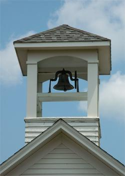 close up shot of the bell tower on a one-room school house